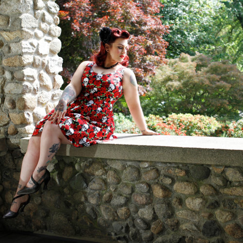 Shimona Henry models a Cherry Velvet dress called Brigitte Bones n' Blooms in a classic pin-up pose