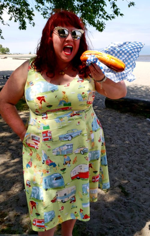 Cherry Velvet's Designer wears the Brigitte Kamp Kitsch dress while eating a hot dog