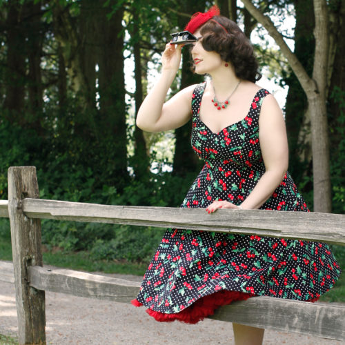 Model Kristen Faith wears Cherry Velvet 's Doris Dress in Black Cherry Dots