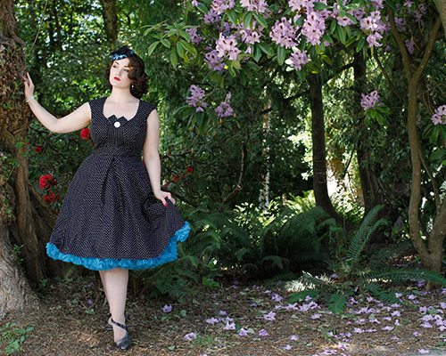 Vintage style model Kristen Meyn wearing a Cherry Velvet polka Dot dress with a hat by Maria Curcic and Fluevog shoes